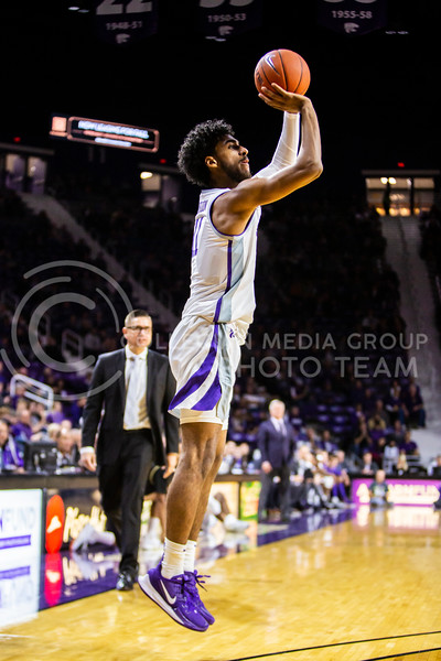 Freshman forward Antonio Gordon jumps up for a shot during K-State's basketball team's home opener against ESU in Bramlage Coliseum on Oct. 25, 2019. The Wildcats held the Hornets 86-49. (Logan Wassall | Collegian Media Group)