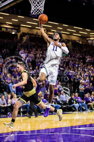 Freshman forward Antonio Gordon charges the basket for a shot during K-State's basketball team's home opener against ESU in Bramlage Coliseum on Oct. 25, 2019. The Wildcats held the Hornets 86-49. (Logan Wassall | Collegian Media Group)