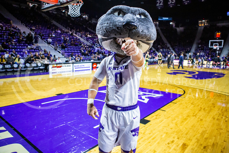 Willie Wildcat leads K-State fans in cheering on their basketball team during their game against ESU in Bramlage Coliseum on Oct. 25, 2019. The Wildcats held the Hornets 86-49. (Logan Wassall | Collegian Media Group)