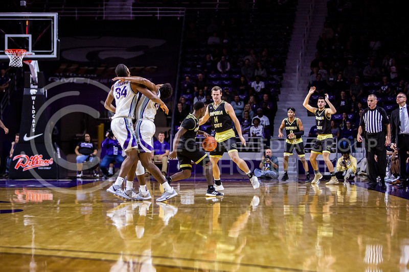 Junior forward Levi Stockard III (left) and senior forward Xavier Sneed (right) collide after a play during K-State's basketball team's home opener against ESU in Bramlage Coliseum on Oct. 25, 2019. The Wildcats held the Hornets 86-49. (Logan Wassall | Collegian Media Group)