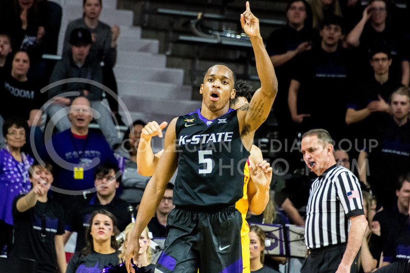 After scoring, K-State guard Barry Brown Jr. points his finger up in celebration. Brown added 20 points to K-State's score during the game against Iowa State on February 27. (Alex Todd | Collegian Media Group)