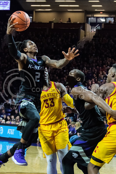 Flying past the defense, K-State guard Cartier Diarra goes in for two points. K-State won 78-66 against Iowa State on Saturday, February 27. (Alex Todd | Collegian Media Group)