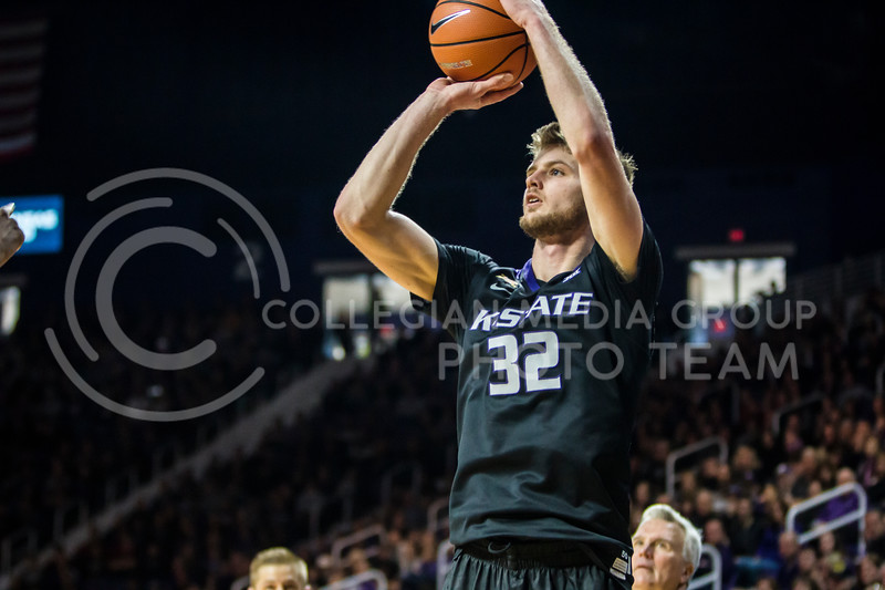 Junior forward, Dean Wade, takes a shot against Iowa State in Bramlage Coliseum on Feb. 17, 2018. The Wildcats defeated the Cyclones 78-66. (Logan Wassall | Collegian Media Group)