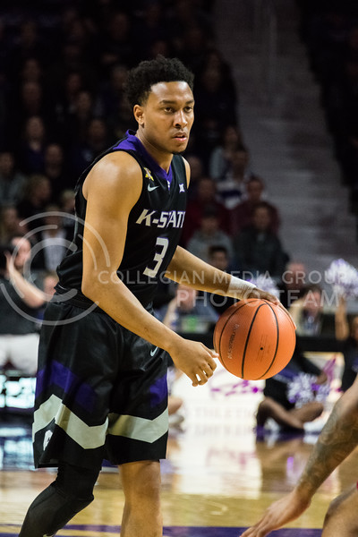 Looking for the next move, K-State guard Kamau Stokes gets ready to advance towards the goal. Stokes contributed 5 points to Saturday's game against Iowa State. (Alex Todd | Collegian Media Group)