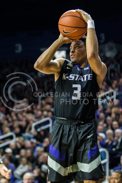 Junior guard, Kamau Stokes, takes a three against Iowa State in Bramlage Coliseum on Feb. 17, 2018. The Wildcats defeated the Cyclones 78-66. (Logan Wassall | Collegian Media Group)
