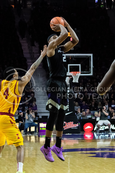 K-State forward Xavier Sneed jumps straight up to drain a three point shot during Saturday's game against Iowa State. (Alex Todd | Collegian Media Group)