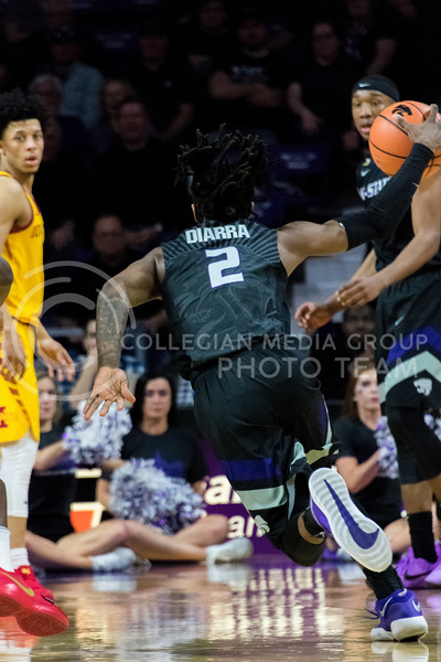 K-State foward Cartier Diarra flies down the court with the ball during Saturday's game against Iowa State. (Alex Todd | Collegian Media Group)
