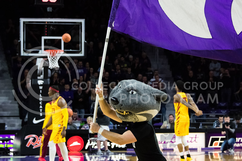 With a few minutes before the game starts, Willie runs onto the court with the K-State flag. (Alex Todd | Collegian Media Group)