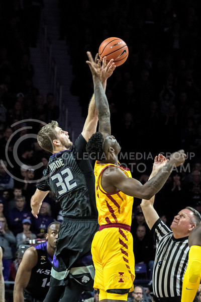 Leaping for the ball, K-State forward Dean Wade gets to the ball first, starting off the game against Iowa State on February 27. (Alex Todd | Collegian Media Group)