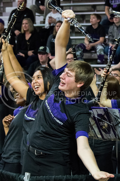The clarinet section shows their wildcat pride during one of the songs at the basketball game at Bramlage Coliseum on February 27. (Alex Todd | Collegian Media Group)