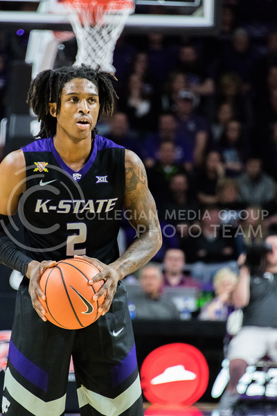 While on the offensive, K-State foward Cartier Diarra sets up the next play during the game against Iowa State on February 27. (Alex Todd | Collegian Media Group)