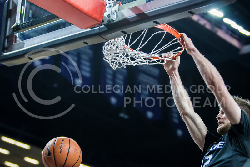 Junior forward, Dean Wade, slams down the basketball into the goal against Iowa State in Bramlage Coliseum on Feb. 17, 2018. The Wildcats defeated the Cyclones 78-66. (Logan Wassall | Collegian Media Group)