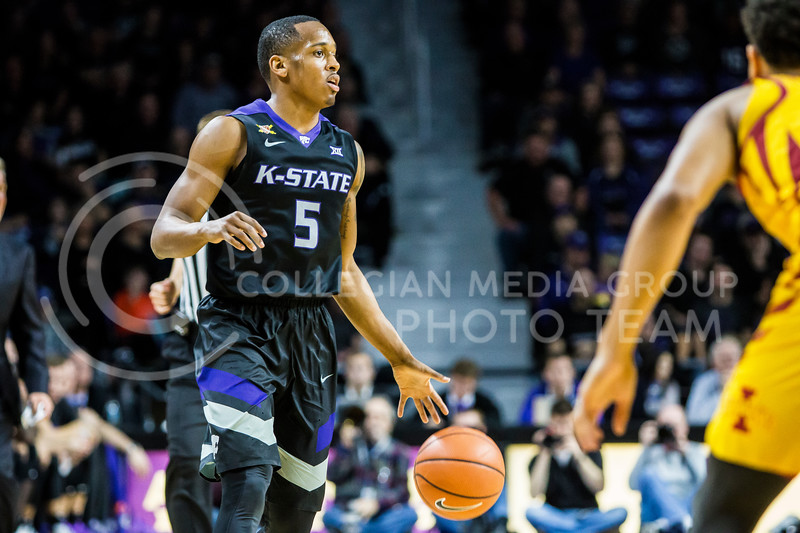 Junior guard, Barry Brown, JR. scans the court as he prepares for a play against Iowa State in Bramlage Coliseum on Feb. 17, 2018. The Wildcats defeated the Cyclones 78-66. (Logan Wassall | Collegian Media Group)
