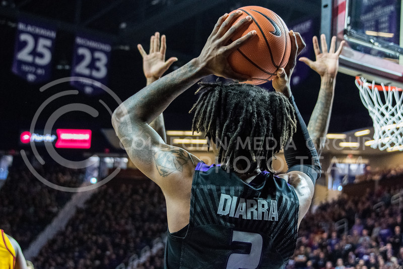 After an out of bounds call, K-State foward Cartier Diarra looks for an open teammate to pass to during Saturday's game against Iowa State. (Alex Todd | Collegian Media Group)