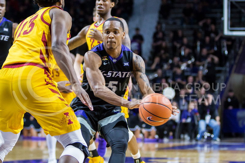Junior guard, Barry Brown, JR., passes the ball against Iowa State in Bramlage Coliseum on Feb. 17, 2018. The Wildcats defeated the Cyclones 78-66. (Logan Wassall | Collegian Media Group)