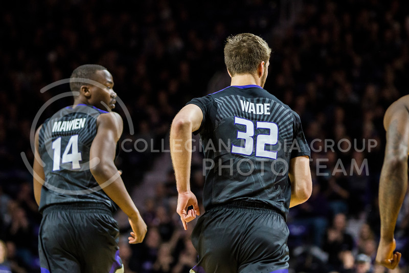 Junior forward, Dean Wade, and sophomore forward, Makol Mawien, rush back on defense against Iowa State in Bramlage Coliseum on Feb. 17, 2018. The Wildcats defeated the Cyclones 78-66. (Logan Wassall | Collegian Media Group)