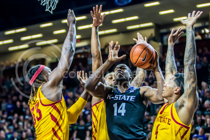 Sophomore forward, Makol Mawien bursts through the Cyclones' defense to take a shot in Bramlage Coliseum on Feb. 17, 2018. The Wildcats won 78-66. (Logan Wassall | Collegian Media Group)