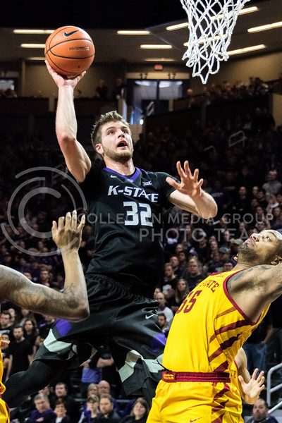 K-State forward Dean Wade jumps right over the Iowa State defense to score two points. With a 39 minute playtime, Wade scored 22 points during Saturday's game at Bramlage Coliseum. (Alex Todd | Collegian Media Group)