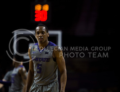 Sophomore gaurd Barry Brown stands on the court during the basketball game between K-State and Oklahoma State in Bramlage Colisium on Feb. 22, 2017. (Emily Starkey | The Collegian)