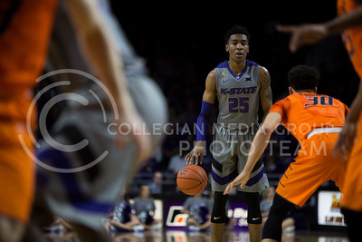 Senior forward Wesley Iwundu dribbles the ball during the basketball game between K-State and Oklahoma State in Bramlage Colisium on Feb. 22, 2017. (Emily Starkey | The Collegian)