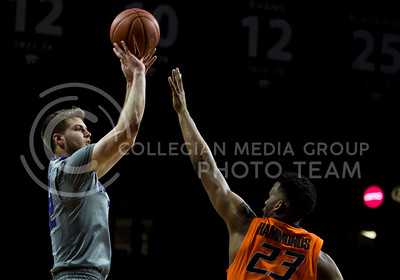 Sophomore forward Dean Wade shoots the ball during the basketball game between K-State and Oklahoma State in Bramlage Colisium on Feb. 22, 2017. (Emily Starkey | The Collegian)