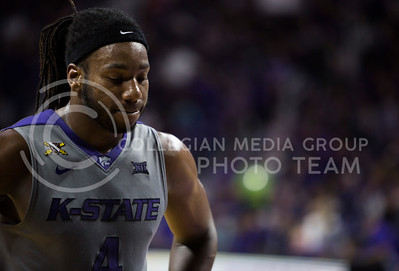 Senior forward DJ Johnson looks down during the basketball game between K-State and Oklahoma State in Bramlage Colisium on Feb. 22, 2017. (Emily Starkey | The Collegian)