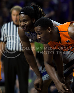 Senior forward DJ Johnson laughs during a free throw during the basketball game between K-State and Oklahoma State in Bramlage Colisium on Feb. 22, 2017. (Emily Starkey | The Collegian)