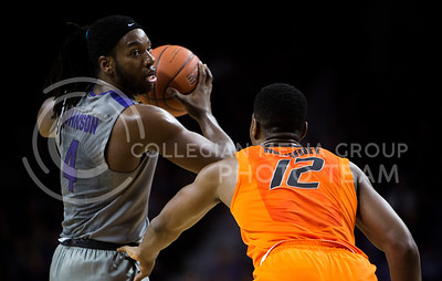 Senior forward DJ Johnson llooks for an open teammate during a free throw during the basketball game between K-State and Oklahoma State in Bramlage Colisium on Feb. 22, 2017. (Emily Starkey | The Collegian)