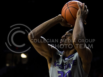 Freshman forward Xavier Sneed shoots the ball during the basketball game between K-State and Oklahoma State in Bramlage Colisium on Feb. 22, 2017. (Emily Starkey | The Collegian)