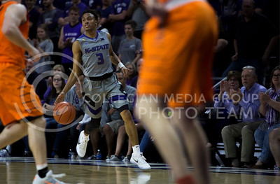 Sophomore gaurd Kamau Stokes pushes the ball down the court during the basketball game between K-State and Oklahoma State in Bramlage Colisium on Feb. 22, 2017. (Emily Starkey | The Collegian)