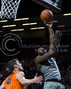 Senior forward DJ Johnson shoots a layup during the basketball game between K-State and Oklahoma State in Bramlage Colisium on Feb. 22, 2017. (Emily Starkey | The Collegian)