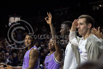 On Jan. 20, 2018, K-State players cheer on their teammates as they play against TCU in Bramlage Coliseum. The Wildcats took the Horned Frogs 73-68. (Logan Wassall | Collegian Media Group)
