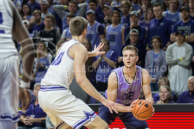 On Jan. 20, 2018, junior forward, Dean Wade, takes a shot against TCU in Bramlage Coliseum. The Wildcats took the Horned Frogs 73-68. (Logan Wassall | Collegian Media Group)