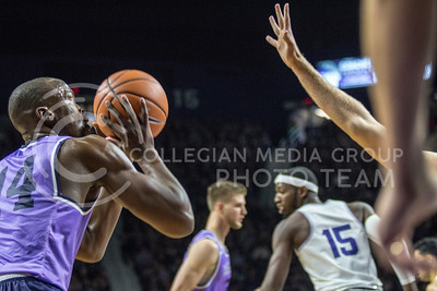 On Jan. 20, 2018, sophomore forward, Makol Mawien, takes a shot against TCU in Bramlage Coliseum. The Wildcats took the Horned Frogs 73-68. (Logan Wassall | Collegian Media Group)