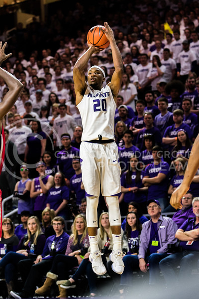 Contributing a total of 9 points to Saturday's game at Bramlage Coliseum, Wildcat Forward Xavier Sneed jumps up to execute a well timed shot for 3 points. (Alex Todd   Collegian Media Group)