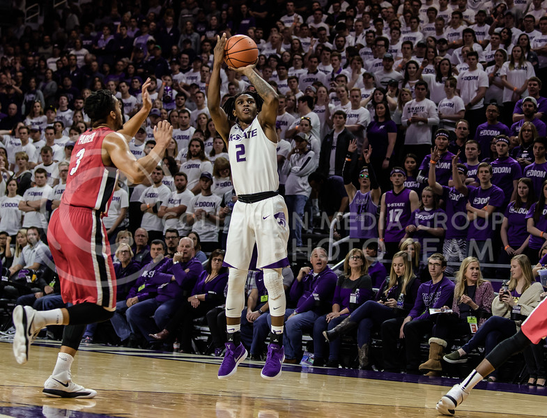 Right on time the Kansas State Wildcat Freshman Guard Cartier Diarra takes his shot while Georgia Bulldog Senior Guard Juwan Parker struggles to block him. At Bramlage Coliseum on Saturday, KSU took the victory against UGA with a final score of 56-51; 12 of the points belonged to Diarra. (Olivia Bergmeier   Collegian Media Group)