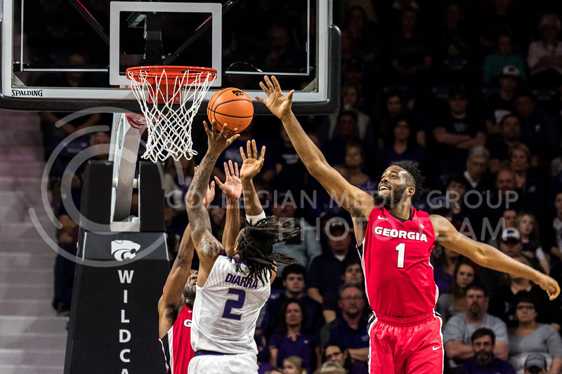 K-State redshirt freshman Cartier Diarra drives one home while Georgia's Yante Maten leaps up for the block. (Alex Todd   Collegian Media Group)