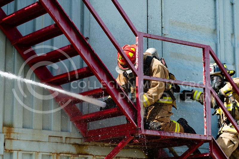 A Manhattan Fire Department recruit checks the hose nozzle before entering the pracrtice building where the controll burn is located. On Tuesday, June 26, 2018, the fire department ran controll burns for the recruits. (Olivia Bergmeier | Collegian Media Group)