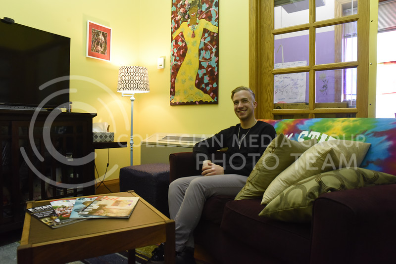 Seth Peery, a Senior in Medical Biochemistry, lounges in the LGBT Resource Center in Holton Hall. He has worked there for the last seminar, while being involved with SAGA for over three years. (John Chapple | Collegian Media Group)