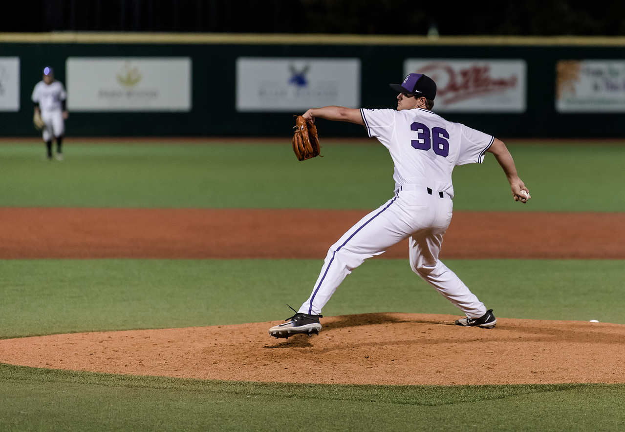 Freshman right-handed pitcher Quinton Potter steps to pitch the ball towards home plate. The Kansas State Wildcats lost against the Chreighton Bluejays on Tuesday at Tointon Family Stadium. (Olivia Bergmeier | Collegian Media Group)