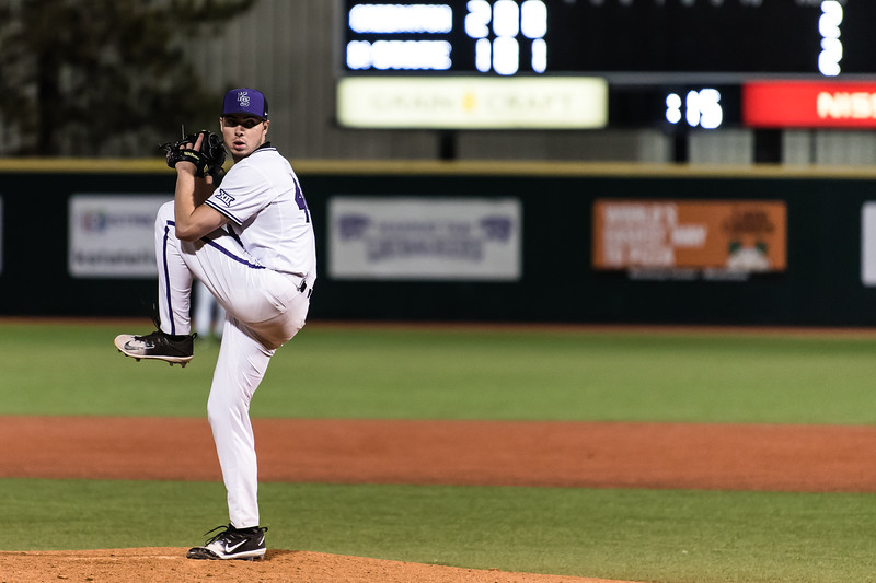 Winding up for a pitch, junior right-handed pitcher Mitch Zubradt looks towards junior catcher TK Mcwhertor against the Creighton Bluejays. The K-State Wildcats faced off against the Bluejays on Tuesday. (Olivia Bergmeier | Collegian Media Group)