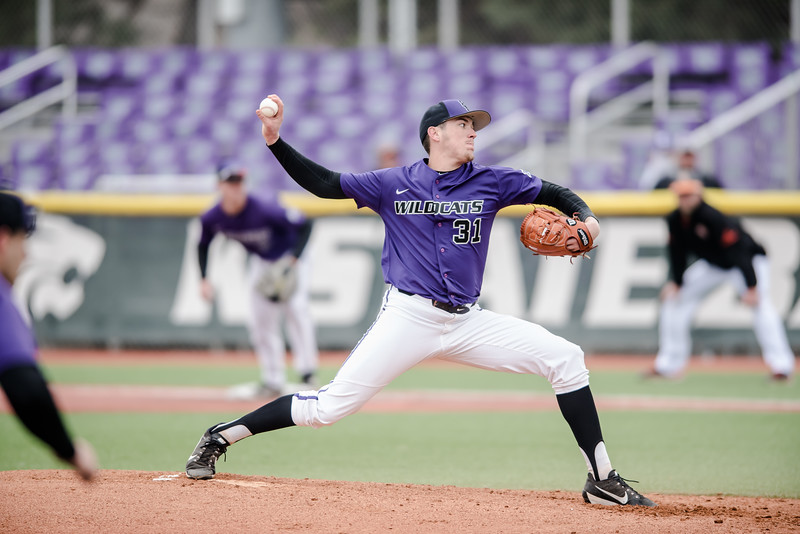 K-State Wildcat senior right-hand pitcher Justin Hestett prepares to let loose the ball towards a Mercer Bear Hitter. The Kansas State Wildcat baseball team faced off against the Mercer Bears on Sunday. (Olivia Bergmeier | Collegian Media Group)