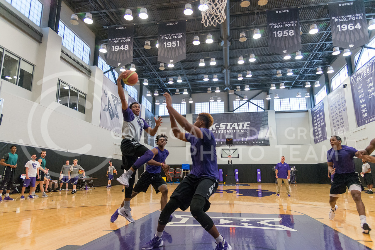 Kamau Stokes, sophomore, goes for a layup during team practice on June 28, 2016. (Evert Nelson | The Collegian)