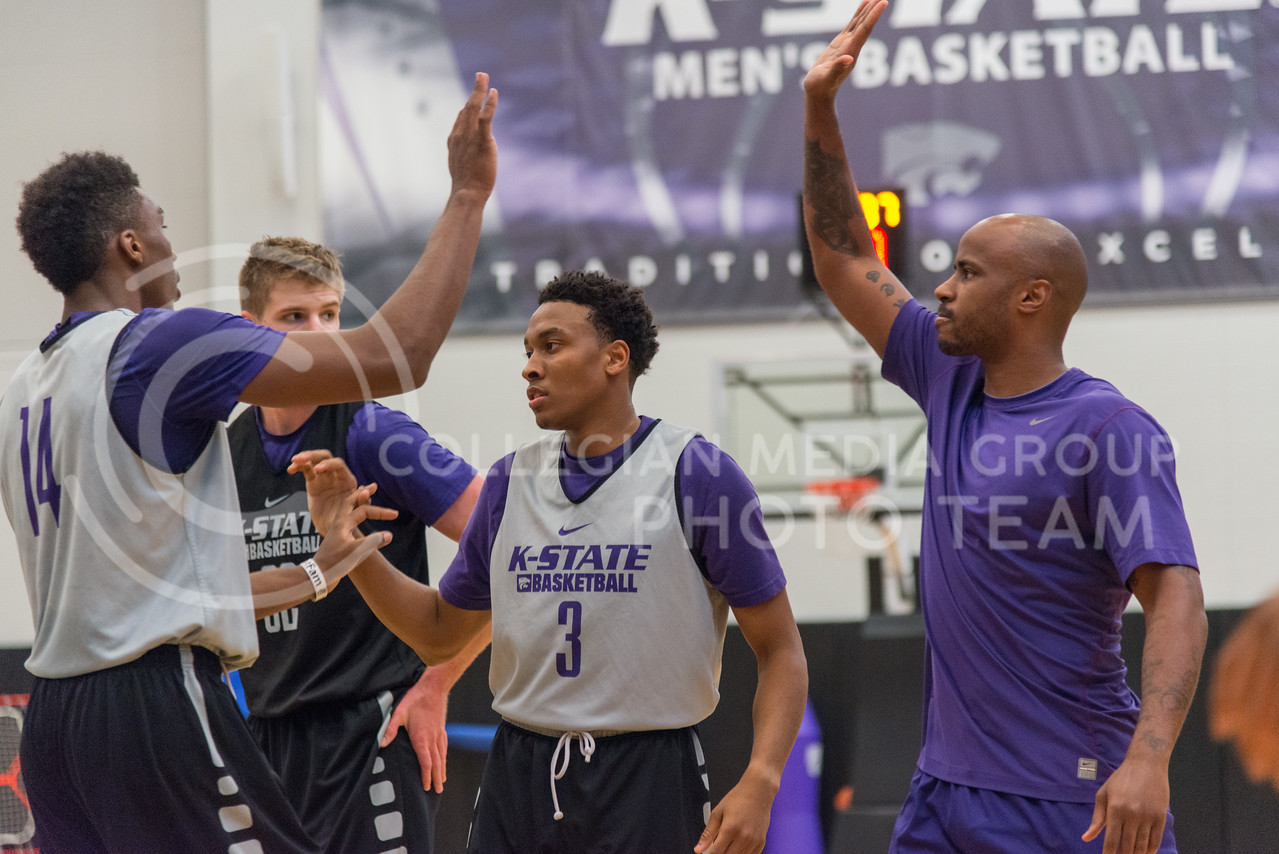 Kamau Stokes, #3 sophomore, high fives teammates during practice on June 28, 2016. (Evert Nelson | The Collegian)