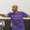 Chester Frazier, assistance coach, points and yells toward players during the Wildcats third team practice on June 28, 2016. (Evert Nelson | The Collegian)