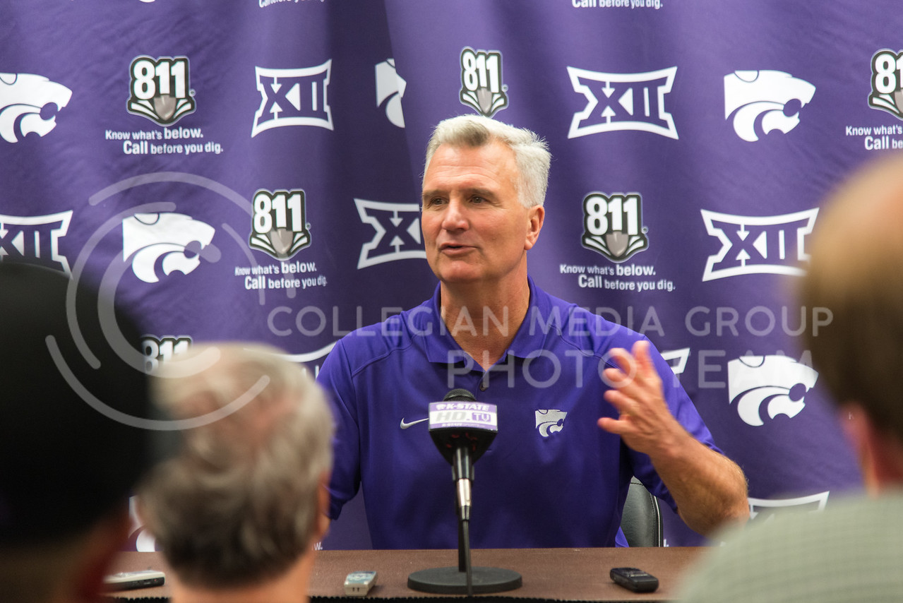 Coach Bruce Weber talks with members of the press during the Wildcats third team practice on June 28, 2016. (Evert Nelson | The Collegian)