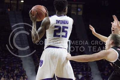 Senior forward Wesley Iwundu guards the ball during the K-State basketball game against the University of Nebraska-Omaha in Bramlage Coliseum on Nov. 15, 2016. (Kelly Pham | The Collegian)