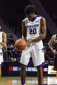 Freshman forward Xavier Sneed prepares to shoot a free throw during the K-State basketball game against the University of Nebraska-Omaha in Bramlage Coliseum on Nov. 15, 2016. (Kelly Pham | The Collegian)