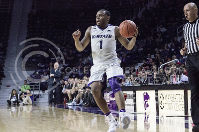 Senior guard Carlbe Ervin II dribbles during the K-State basketball game against the University of Nebraska-Omaha in Bramlage Coliseum on Nov. 15, 2016. (Kelly Pham | The Collegian)