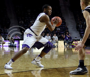 Senior guard Carlbe Ervin II dribbles the ball during the K-State basketball game against the University of Nebraska-Omaha in Bramlage Coliseum on Nov. 15, 2016. (Miranda Snyder | The Collegian)